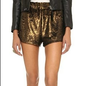 Free People sequin shorts with elastic waist.